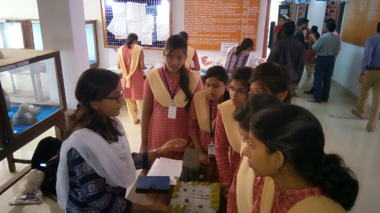 M.Sc. students explaining models in the science exhibition